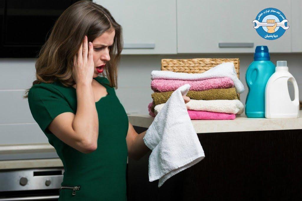 ماندن پودر روی لباس در ماشین لباسشویی